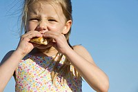 Girl eating sandwich outdoors