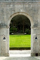 Arch and green lawn at palace Sintra, Portugal
