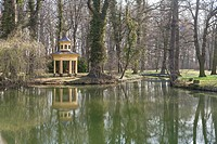 Chinese Pavilion reflected in the castle pond, Spring Snowflakes blossoming in the Jahnishausen castle grounds near Riesa, river Jahna, in spring, Sax...