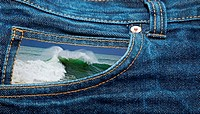 A blue jeans pocket with a green wave