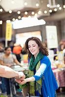 Hispanic woman shopping for food in farmer´s market