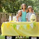 Caucasian children with lemonade stand