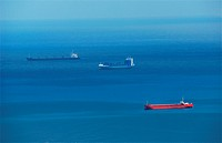 Cargo ships in blue sea