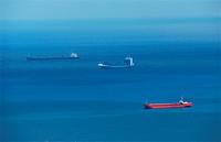 Cargo ships in blue sea