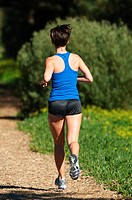 The back of a woman running on a path