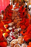 Monks eating a meal on Meak Bochea Makha Bucha holiday, Udong, Cambodia, Indochina, Southeast Asia, Asia