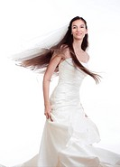 portrait of a bride with long dark hair in wedding dress _ isolated on white