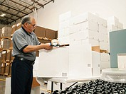 Warehouse worker sealing boxes