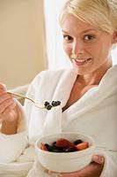 Woman eating fresh fruits