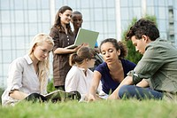 University students studying together outdoors, low angle view
