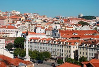 View over city with statue of King Dom Pedro IV on column, Rossio Square, Pombaline Lower Town, Central Lisbon, Portugal, november