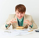 Happy person is going to eat on workplace