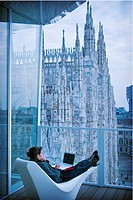Woman with computer, The Cube, Milan, Italy