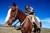 Argentina, Patagonia, Santa Cruz province, estancia Menelik Menelik farm, Perito Moreno national park, portrait of Francho gaucho riding a horse