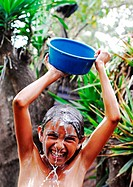 Guatemala, Los Achiotes, teenager Odalis Arcely Rodriguez Lopez 11 years taking bath outside