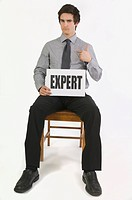 Businessman holding an expert sign