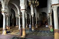 North Africa, Tunisia, Kairouan. Holly city. The Great Mosque Sidi Okba, World Heritage of Unesco. Sacred place of Islam. Man in prayer.