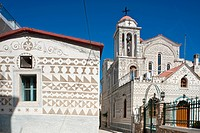 Greece, Chios Island, the Medieval village of Pyrghi is part of Mastikochoria Mastic producing villages, houses decorated with geometric patterns obta...