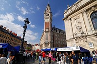 France, Nord, Lille, Braderie de Lille Flea Market, Stalls of the flea market in front of the belfry of the CCI Lille