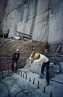 Workers in granite quarry.