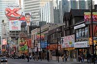Canada, Ontario, Toronto, Yonge Street, Downtown Yonge, street scene, shopping, business, storefront, sign, advertising, billboard, variety, pedestria...