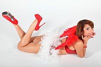 Young woman posing dressed as Cupid lying in the Studio