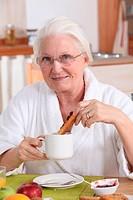 grandmother having breakfast
