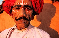 Folk dancer before performing the Kachhi ghodi dance. From Rajasthan, India. The Kachhi ghodi dance can be translated in the horse dance in english. T...