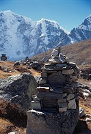 Cairns with mountains in the background, near Dibouche, Nepal.