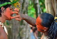 Marquesan dancers apply bodypaint as part of costume, Koueva, Nuku Hiva, Marquesas Islands, French Polynesia