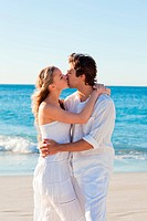 Kissing couple on the beach