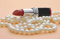 Lipstick with a pearl necklace