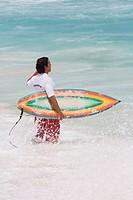 Brazilian surfer. Copacabana Beach, Rio de Janeiro, Brazil.