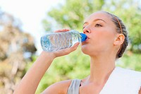 Athletic woman taking a drink of water