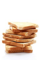 Stacked slices of toast, toasted slices of bread