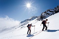 Hikers on Weissbrunnferner Mountain during the ascent to Hinterer Eggenspitz Mountain in the Val d'Ultimo, with the summit of Hinterer Eggenspitz Moun...