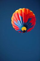 Hot Air Balloon in flight, clear blue sky