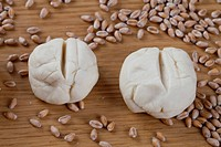 Dough shaped into rolls, wheat grains