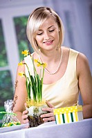 Woman with daffodils, Easter arrangement