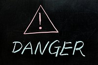 Chalk drawing _ Danger sign and text