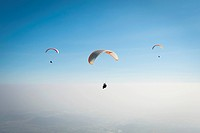 Paragliding above the clouds, Monte Grappa, Italy, Europe