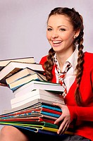 Young beautiful girl laughing catches books