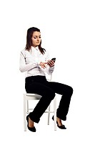 Attractive business woman replying to an email on her smart phone - Isolated