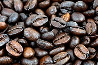 Food and drink background: beautiful detailed macro shot of dark roast coffee beans.