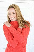 Smiling woman wearing sweater