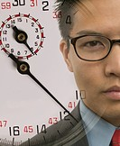 Young businessman with superimposed stopwatch image