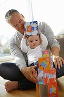 Father and baby playing with blocks