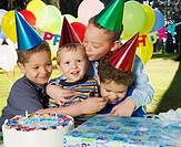 Group of boys hugging at birthday party
