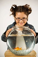 Young girl holding a fishbowl
