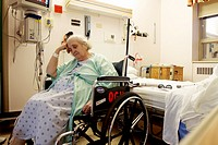an elderly woman in a wheelchair in a hospital